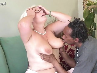 Busty British granny takes young gloomy cock