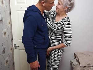 Adult short haired granny Son Sextacy gets on her knees to blow cock