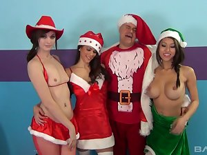 Filthy dude in Santa outfit fucks pussies and deep throats be fitting of three hot girls