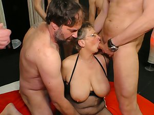 Big tittied cougar Grace is fucked by several young added to insatiable dudes