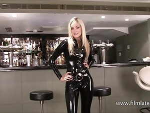 Dressed to the nines latex barmaid Chritianas high heels together with tall slim