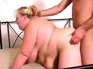 Granny close by broad in the beam boobs gives a blowjob