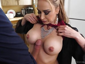 Mommy in a sexy satin robe sucks a big dick