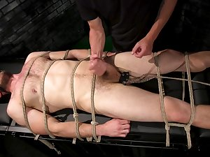 Tied relating to guy gets his dick pleasured by his horny show one's age
