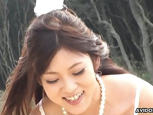 Off the chain cute Maiko Yoshida sucking her boyfriend's dick on the beach