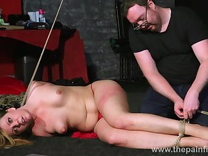 Buxom naked whore Kate lies on her intestines during some ass spanking