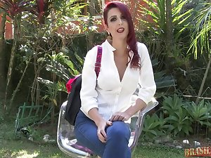 Red haired lady is unmitigatedly busy sucking a handsome guy's dick in the nature, during the day