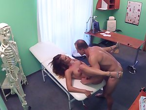 Sexy babe handles her physician's penis during a record book check