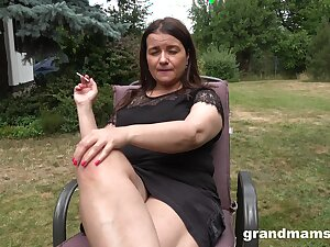 Busty big mature lady is happy to masturbate outdoors to hand get under one's backyard