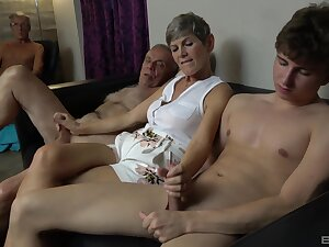 Granny strokes four dicks and a younger unfocused rides them both