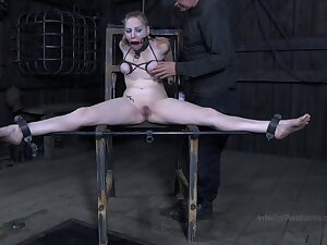 Torture session with ass flogging and pussy poking for Delirious Hunter