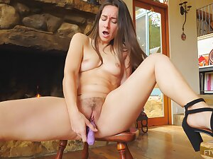 Handsome pornstar Cassidy opens her fingertips to masturbate on the chair